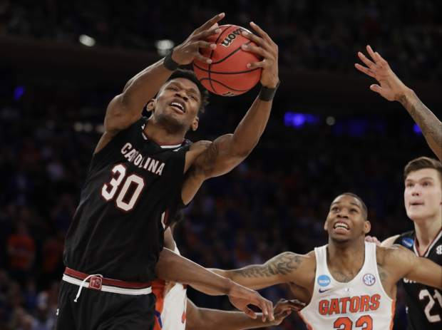 South Carolina forward Chris Silva (30) grabs a rebound against Florida during the second half of the East Regional championship game of the NCAA men's college basketball tournament, Sunday, March 26, 2017, in New York. (AP Photo/Julio Cortez)
