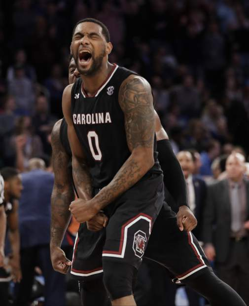 South Carolina guard Sindarius Thornwell (0) reacts after dunking the ball against Florida during the second half of the East Regional championship game of the NCAA men's college basketball tournament, Sunday, March 26, 2017, in New York. South Carolina won 77-70. (AP Photo/Julio Cortez)