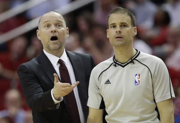 Denver Nuggets coach Michael Malone, left, gestures as referee Mark Lindsay (29) listens during the second half of an NBA basketball game against the Houston Rockets Monday, March 20, 2017, in Houston. The Rockets won 125-124. (AP Photo/David J. Phillip)