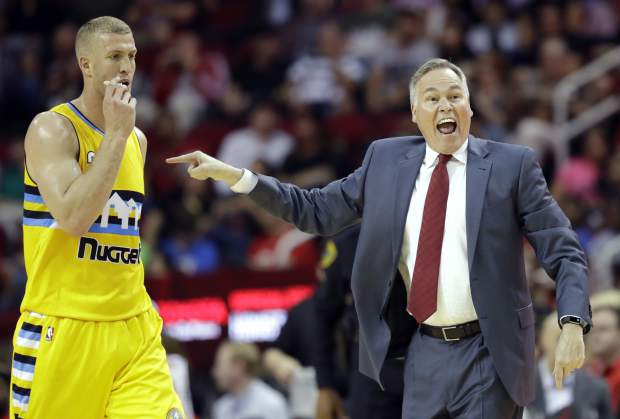 Houston Rockets coach Mike D'Antoni, right, yells at the officials as Denver Nuggets' Mason Plumlee, left, walks toward the bench during the first half of an NBA basketball game Monday, March 20, 2017, in Houston. (AP Photo/David J. Phillip)