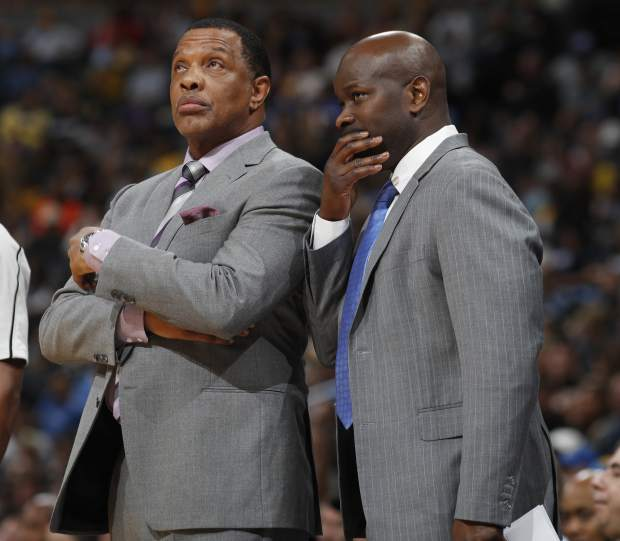 New Orleans Pelicans coach Alvin Gentry, left, confers with assistant coach Robert Pack during the second half of the team's NBA basketball game against the Denver Nuggets on Sunday, March 26, 2017, in Denver. The Pelicans won 115-90. (AP Photo/David Zalubowski))