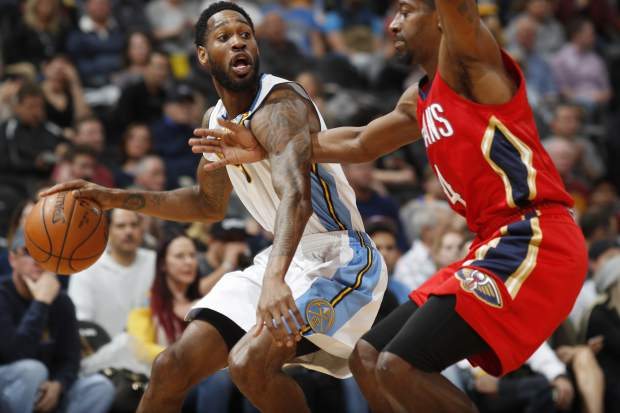 New Orleans Pelicans guard Jordan Crawford, right, defends Denver Nuggets guard Will Barton during the second half of an NBA basketball game Sunday, March 26, 2017, in Denver. The Pelicans won 115-90. (AP Photo/David Zalubowski))
