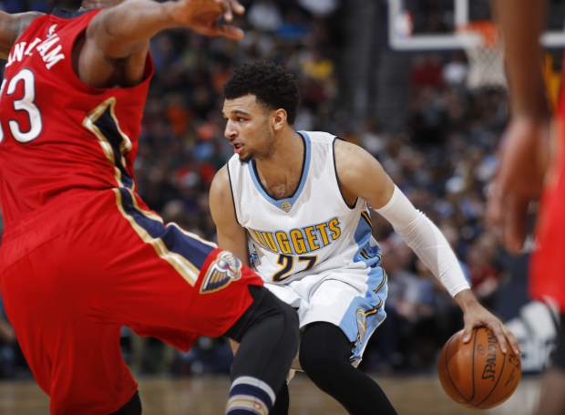 New Orleans Pelicans forward Dante Cunningham, front, stops Denver Nuggets guard Jamal Murray as he tries to drive the lane during the second half of an NBA basketball game Sunday, March 26, 2017, in Denver. The Pelicans won 115-90. (AP Photo/David Zalubowski))