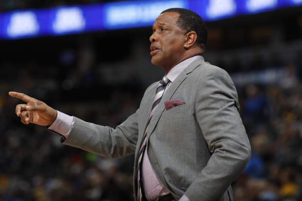 New Orleans Pelicans coach Alvin Gentry gestures to his team during the first half of an NBA basketball game against the Denver Nuggets on Sunday, March 26, 2017, in Denver. (AP Photo/David Zalubowski))