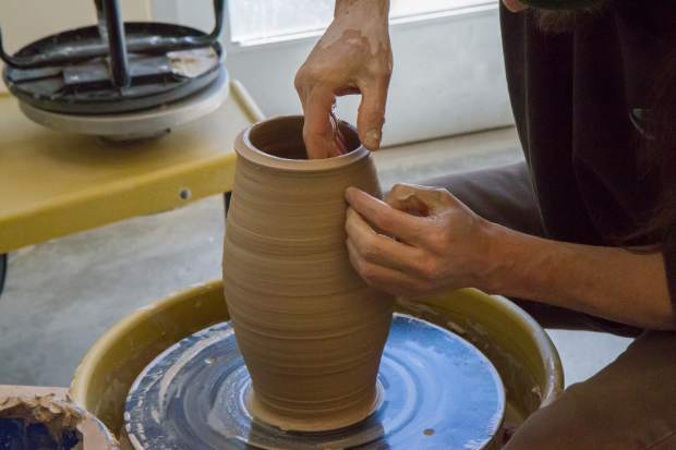 Jeff Knez works on a pot in Michelle McCurdy's ceramics class at the CMC Rifle campus.