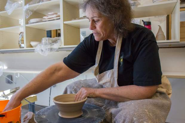 CMC Rifle adjunct ceramics instructor Michelle McCurdy works on one of 400 bowls for the Empty Bowls event at Grand River Health.