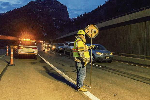 The first line of cars to travel through Glenwood Canyon lines up after a weeklong closure in February.