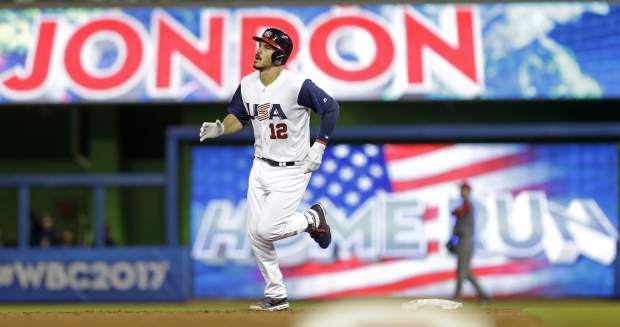 United States' Nolan Arenado rounds second base after hitting a three-run home run against Canada in the second inning in a first-round game of the World Baseball Classic, Sunday, March 12, 2017, in Miami. Adam Jones and Christian Yelich also scored on the home run. The United States won 8-0. (AP Photo/Alan Diaz)