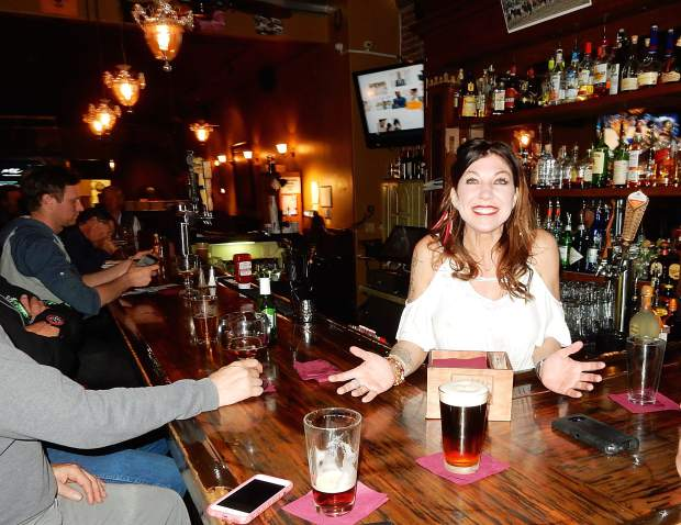 Bartender Margot Moselle serves a black-and-tan beer Wednesday at the Brick Pony, a popular watering hole and restaurant on Basalt's Midland Avenue.