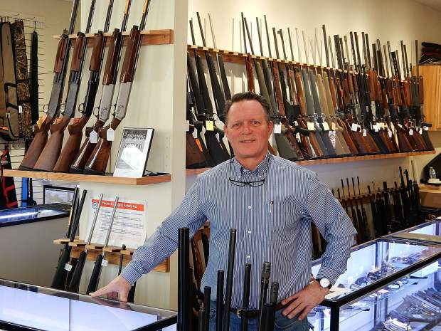 Larry Emery displays some of the inventory of guns at Basalt Firearms at its showroom on Midland Avenue. It's one of the few retail shops to expand in Basalt during and after the recession.