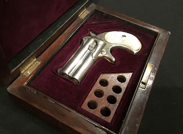 This 1866 Remington derringer is said to be one of the few possessions found in Doc Holliday's room at the Hotel Glenwood after he died.