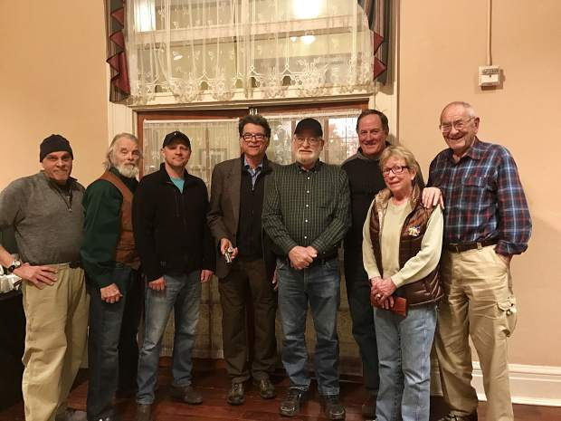 Several members of the Glenwood Springs Historical Society and Frontier Museum gathered to see Doc Holliday's derringer at the Hotel Colorado Wednesday. They are Mike Miller, Holliday expert R. W.