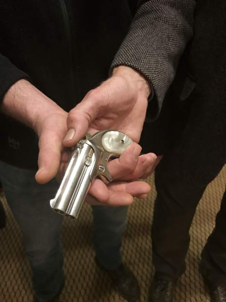 Jason Brierley and Bill Kight hold Doc Holliday's derringer. On Thursday afternoon, the Glenwood Springs Historical Society, where Kight is executive director, agreed to purchase the gun from Brierley. The society will plan for the artifact's exhibition so it's soon available for public viewing.