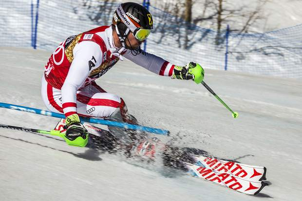 charges down the slalom course Sunday during World Cup Finals.