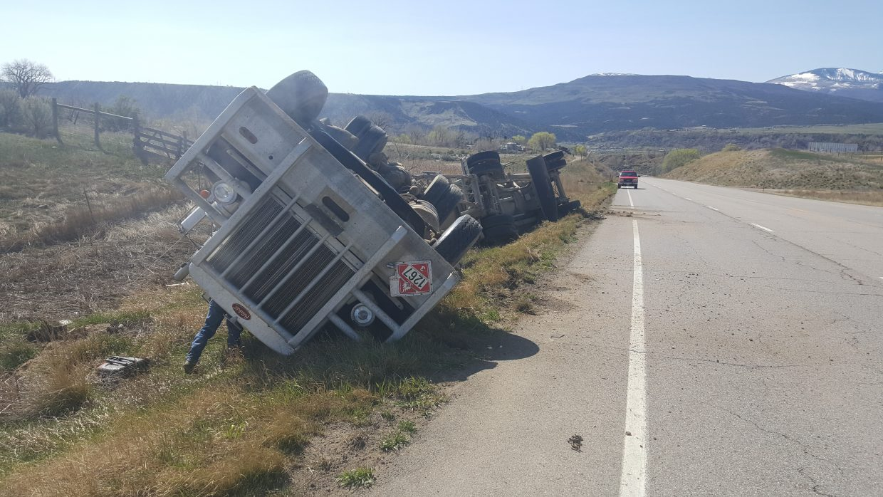 After briefly reopening CO 13 had to close for several hours on Monday afternoon for cleanup after a semi truck rolled over at mile marker 1.5 in Rifle.