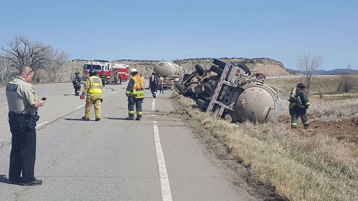 A semi truck rolled over Monday in Rifle on Colorado Highway 13, closing the road for several hours. According to the hazmat placard on the truck, it was carrying crude oil.