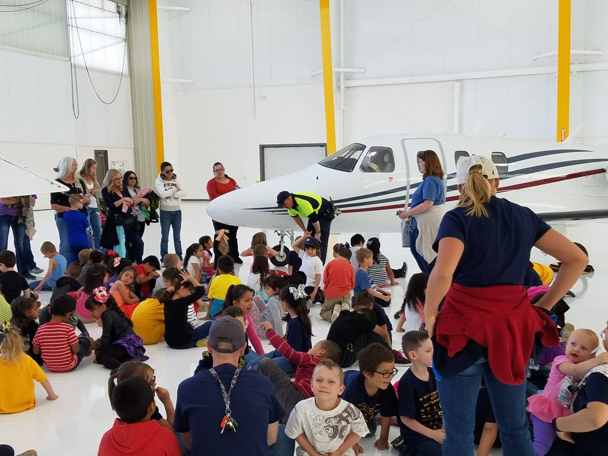 Atlantic Aviation opened a hanger and showed the kids line operations and services performed on the airplane. They learned all about the different part of a plane and what they do.