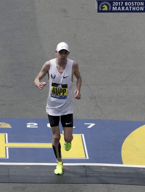 Galen Rupp, of the United States, crosses the finish line in second place in the 121st Boston Marathon on Monday, April 17, 2017, in Boston. (AP Photo/Charles Krupa)