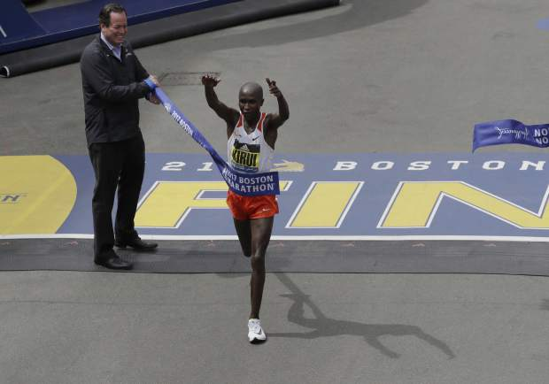 Geoffrey Kirui, of Kenya, crosses the finish line to win the 121st Boston Marathon on Monday, April 17, 2017, in Boston. (AP Photo/Charles Krupa)
