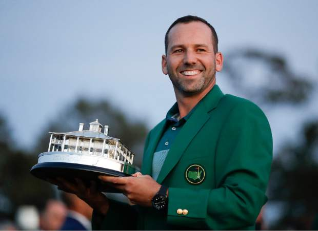 Sergio Garcia, of Spain, holds his trophy at the green jacket ceremony after the Masters golf tournament Sunday, April 9, 2017, in Augusta, Ga. (AP Photo/David Goldman)