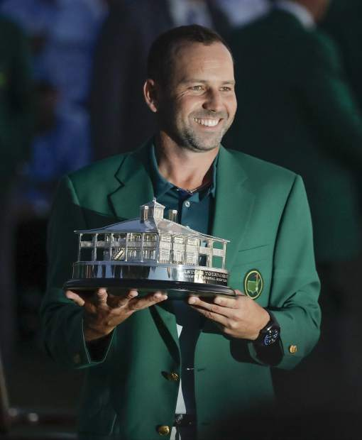 Sergio Garcia, of Spain, holds his trophy at the green jacket ceremony after the Masters golf tournament Sunday, April 9, 2017, in Augusta, Ga. (AP Photo/Charlie Riedel)