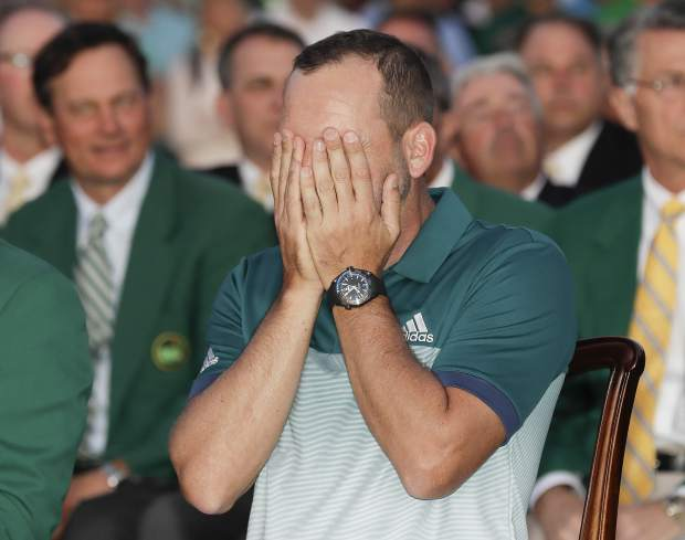 Sergio Garcia, of Spain, reacts at the green jacket ceremony after the Masters golf tournament Sunday, April 9, 2017, in Augusta, Ga. (AP Photo/David J. Phillip)
