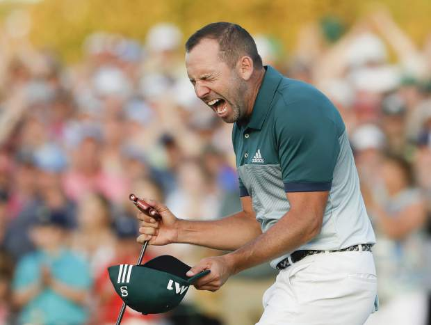 Sergio Garcia, of Spain, reacts after making his birdie putt on the 18th green to win the Masters golf tournament after a playoff Sunday, April 9, 2017, in Augusta, Ga. (AP Photo/Matt Slocum)
