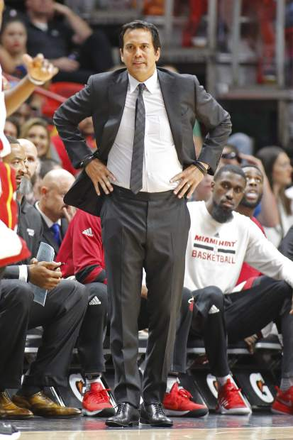 Miami Heat's head Coach Erik Spoelstra reacts to action against the New York Knicks during the first half of an NBA basketball game, Friday, March 31, 2017, in Miami. (AP Photo/Joel Auerbach)