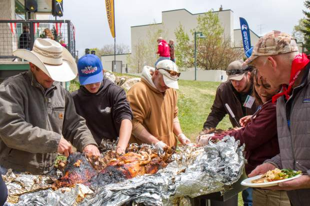Guests take part in the annual Uncle Jimmy's pig roast and carnaval at the CMC Spring Valley Campus.