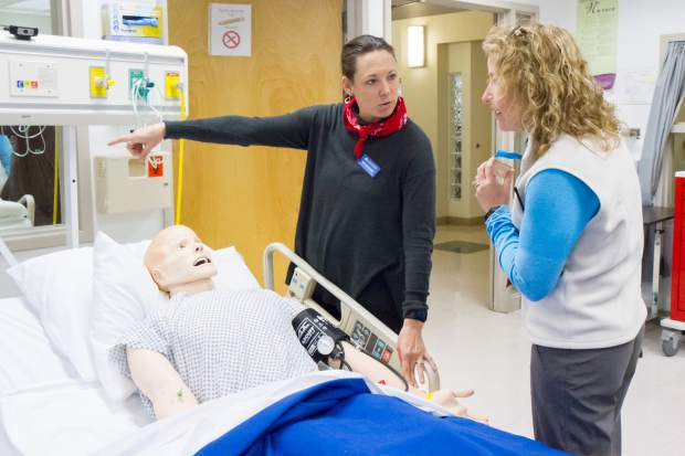 CMC Spring Valley campus nursing instructor Sarah Weatherred explains to Dean of Students Abbie Kroesen the benefits of having a simulation mannequin. The nursing program gave demos during the 50th anniversary celebration at the Spring Valley campus.