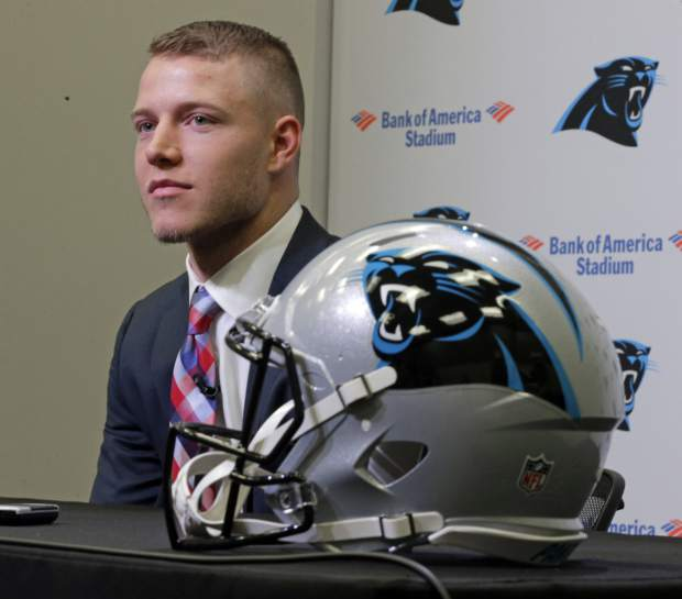 Carolina Panthers first-round draft pick Christian McCaffrey listens to a question during a news conference in Charlotte, N.C., Friday, April 28, 2017. (AP Photo/Chuck Burton)