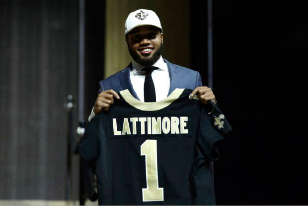 Ohio State's Marshon Lattimore poses after being selected by the New Orleans Saints during the first round of the 2017 NFL football draft, Thursday, April 27, 2017, in Philadelphia. (AP Photo/Matt Rourke)