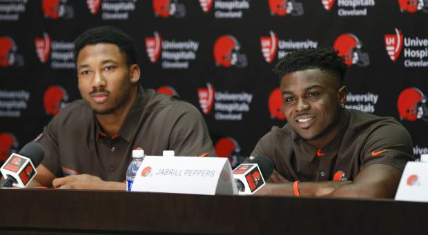 Cleveland Browns' Jabrill Peppers, right, and Myles Garrett answer questions during a news conference at the NFL team's training facility, Friday, April 28, 2017, in Berea, Ohio. (AP Photo/Ron Schwane)