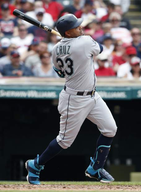 Seattle Mariners' Nelson Cruz hits an RBI-single off Cleveland Indians starting pitcher Josh Tomlin during the sixth inning of a baseball game, Sunday, April 30, 2017, in Cleveland. (AP Photo/Ron Schwane)