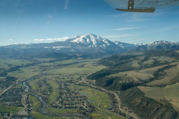 An EcoFlight tour captured this aerial of Mount Sopris and the Ironbridge subdivision. Read about Colorado Mountain College Sustainability Studies student Ellie Langford's use of EcoFlight for her thesis.