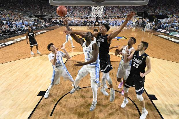 North Carolina's Theo Pinson (1) takes a shot against Gonzaga's Johnathan Williams (3) during the first half in the finals of the Final Four NCAA college basketball tournament, Monday, April 3, 2017, in Glendale, Ariz. (AP Photo/Chris Steppig, Pool)