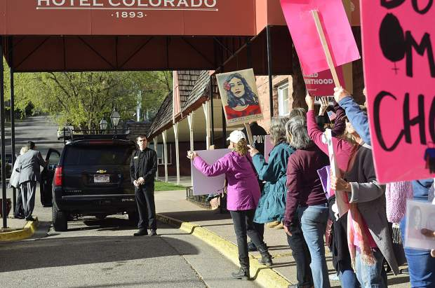 Protesters kept an eye out for Sen. Cory Gardner entering the Hotel Colorado. But however the senator got inside for his fundraiser, he seemed to have slipped through undetected.