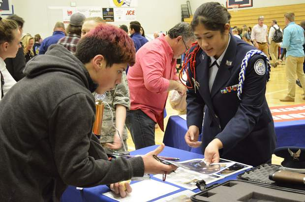 Thaleia Castillo, a member of the Glenwood Springs High School Air Force Junior ROTC, talks with other students about the group at the GlenX career expo Wednesday.