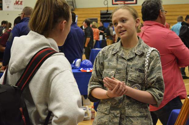 A member of the Glenwood Springs High School Air Force Junior ROTC, Veronyka Wheeler, right, helps the group recruit at a career expo at Roaring Fork High School.