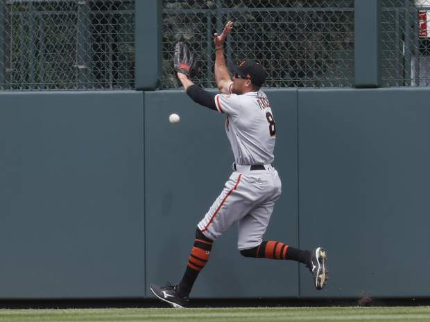 San Francisco Giants right fielder Hunter Pence pursues a triple off the bat of Colorado Rockies' Charlie Blackmon in the first inning of a baseball game, Sunday, April 23, 2017, in Denver.(AP Photo/David Zalubowski)