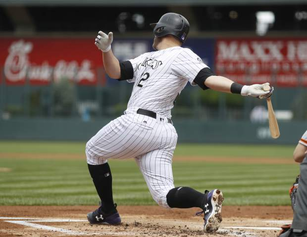 Colorado Rockies' Mark Reynolds strikes out while swinging at a pitch from San Francisco Giants starter Jeff Samardzija to end the first inning of a baseball game Sunday, April 23, 2017, in Denver. (AP Photo/David Zalubowski)