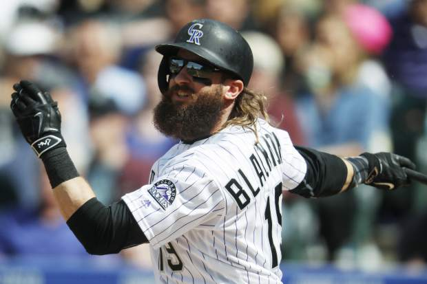 Colorado Rockies' Charlie Blackmon follows the flight of his double to drive in two runs off San Francisco Giants relief pitcher Steven Okert in the sixth inning of a baseball game Sunday, April 23, 2017, in Denver. Colorado won 8-0. (AP Photo/David Zalubowski)