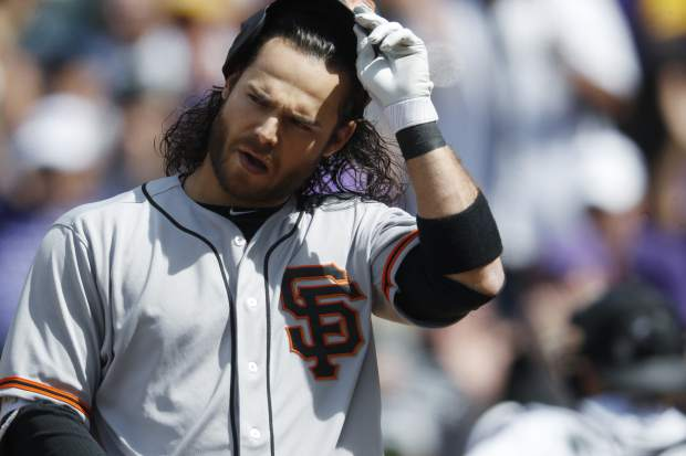 San Francisco Giants' Brandon Crawford reacts after striking out against Colorado Rockies starting pitcher Kyle Freeland to end the top of the sixth inning of a baseball game Sunday, April 23, 2017, in Denver. Colorado won 8-0. (AP Photo/David Zalubowski)