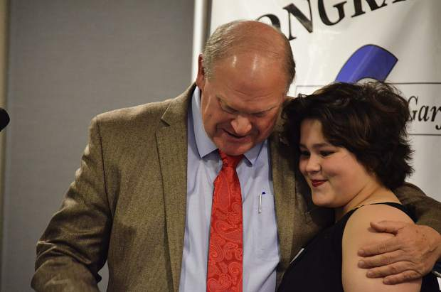 Commissioner Mike Samson awards 16-year-old Chandra Starr the Nourishing the Future Award at the 2017 Garfield County Humanitarian Service Awards.