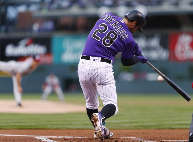 Colorado Rockies' Nolan Arenado flies out on a pitch from Washington Nationals starting pitcher Jacob Turner to end the bottom of the first inning of a baseball game Monday, April 24, 2017, in Denver. (AP Photo/David Zalubowski)