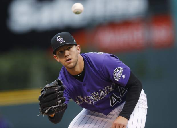 Colorado Rockies starting pitcher Tyler Anderson fields a ball off the bat of Washington Nationals' Trea Turner in the first inning of a baseball game Monday, April 24, 2017, in Denver. (AP Photo/David Zalubowski)