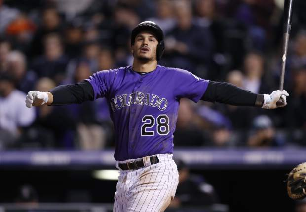 Colorado Rockies' Nolan Arenado swings and misses at a pitch from San Diego Padres relief pitcher Jose Torres in the sixth inning of a baseball game Monday, April 10, 2017, in Denver. Arenado struck out on the next pitch. The Padres won 5-3. (AP Photo/David Zalubowski)