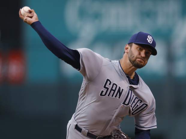 San Diego Padres starting pitcher Jarred Cosart delivers a pitch to Colorado Rockies' Carlos Gonzalez in the first inning of a baseball game Monday, April 10, 2017, in Denver. (AP Photo/David Zalubowski)