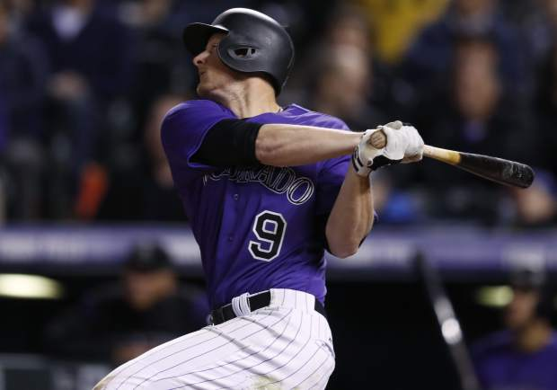 Colorado Rockies' DJ LeMahieu follows the flight of his solo home run off San Diego Padres relief pitcher Jose Torres in the sixth inning of a baseball game Monday, April 10, 2017, in Denver. The Padres won 5-3. (AP Photo/David Zalubowski)