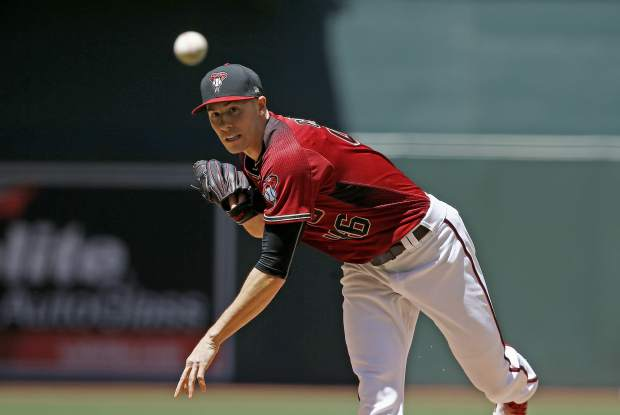 Arizona Diamondbacks' Patrick Corbin throws a pitch against the Colorado Rockies during the first inning of a baseball game Sunday, April 30, 2017, in Phoenix. (AP Photo/Ross D. Franklin)